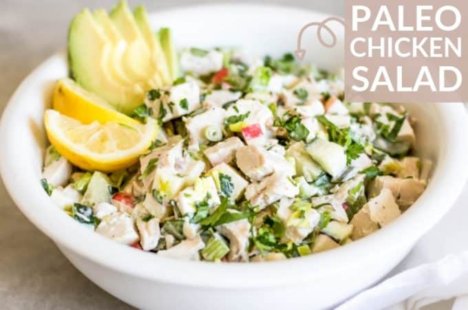 white bowl of whole30 Chicken Salad with avocado and lemon