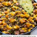 a skillet of ground beef, bacon, dairy free cheese sauce, and avocado sprinkled with cilantro,