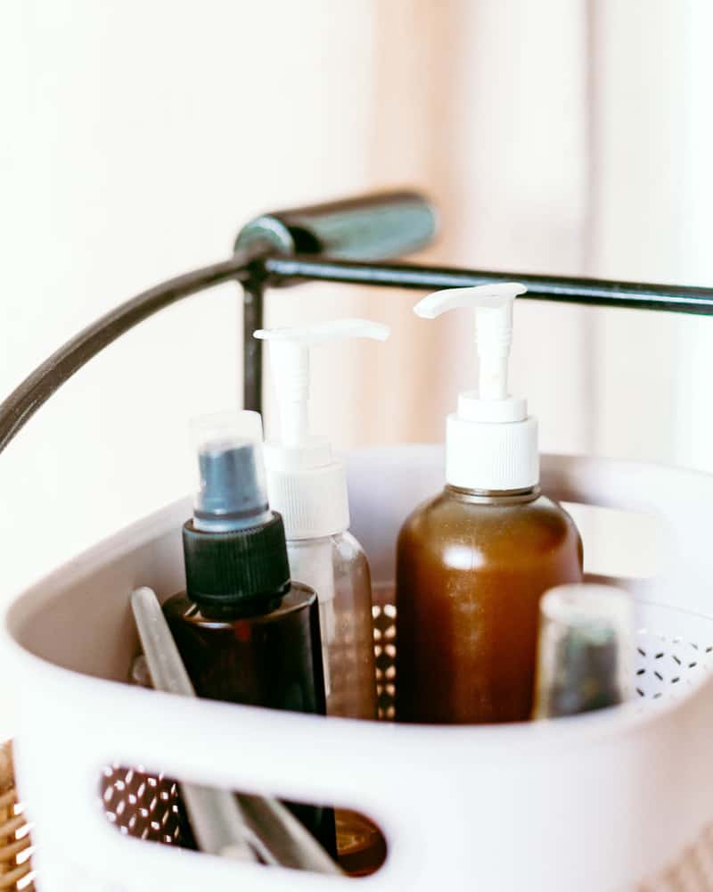 A small bathroom organizer full of natural and organic products