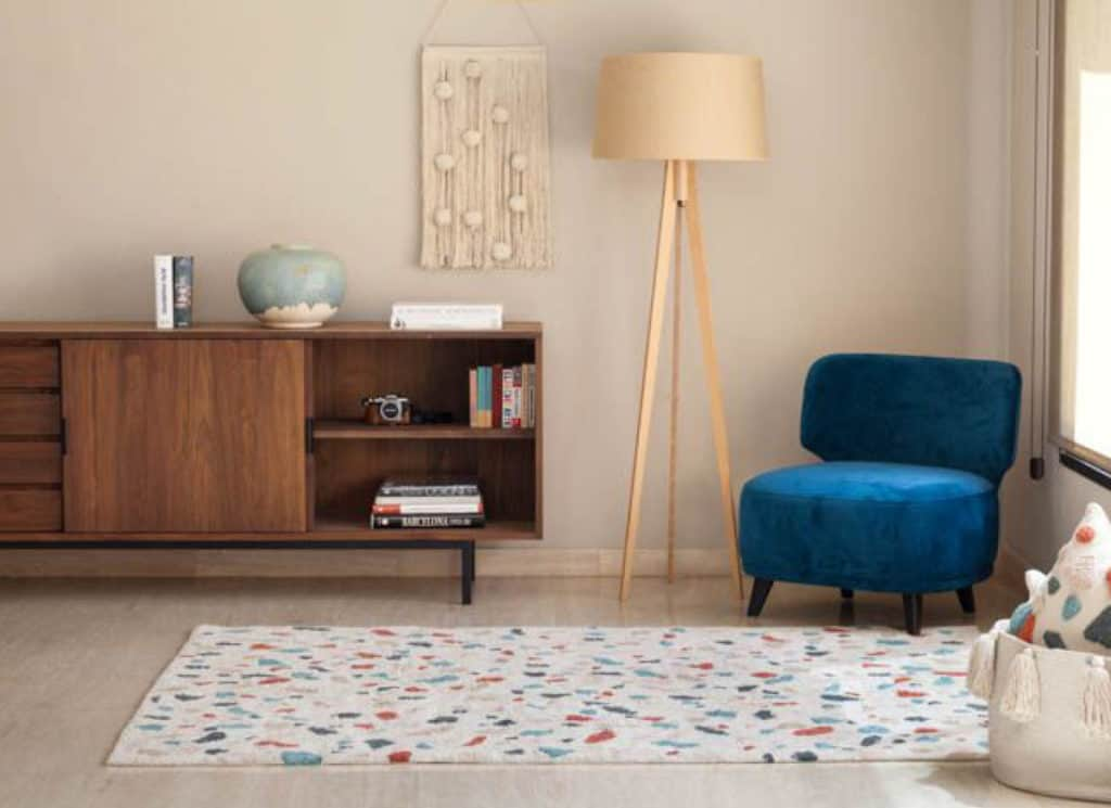 A Scandinavian style room with a terrazzo patterned non toxic rug from Lorena Canals.